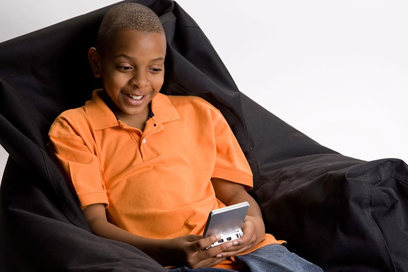 Young boy playing an electronic game
