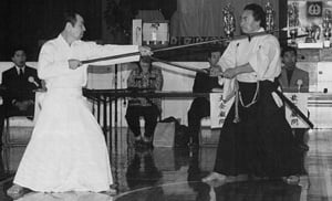 A special exhibition of Nakamura Ryu sword vs. spear techniques was shown by Nakashima Masao (r) and Okahara Shosei (l) during the International Iai-Battodo Federation All Nations Comptetition (the 6th Toyama Ryu - Nakamura Ryu Batto Competition). At the time, this was the first time in over 30 years these techniques had been displayed. Nakashima Sensei, Hanshi 8th dan, was the senior administrator for Narita International Airport.