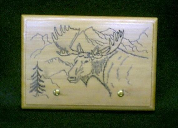 Hand engraved Moose on Sitka Spruce plaque with key hooks... Not a cheap laser imitation... $55.00    Sold but I can always make another...