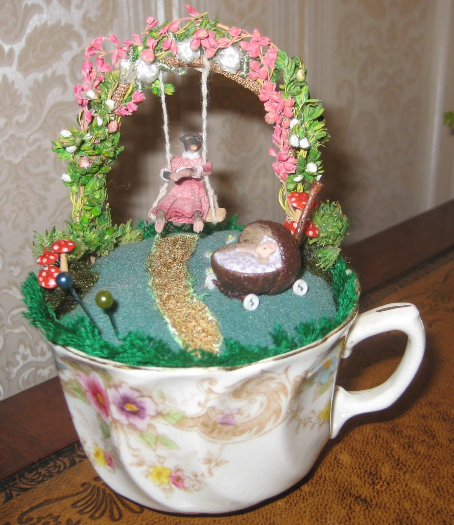 VINTAGE TEACUP PINCUSHION SWINGING MOUSE WITH DOLL IN PRAM
