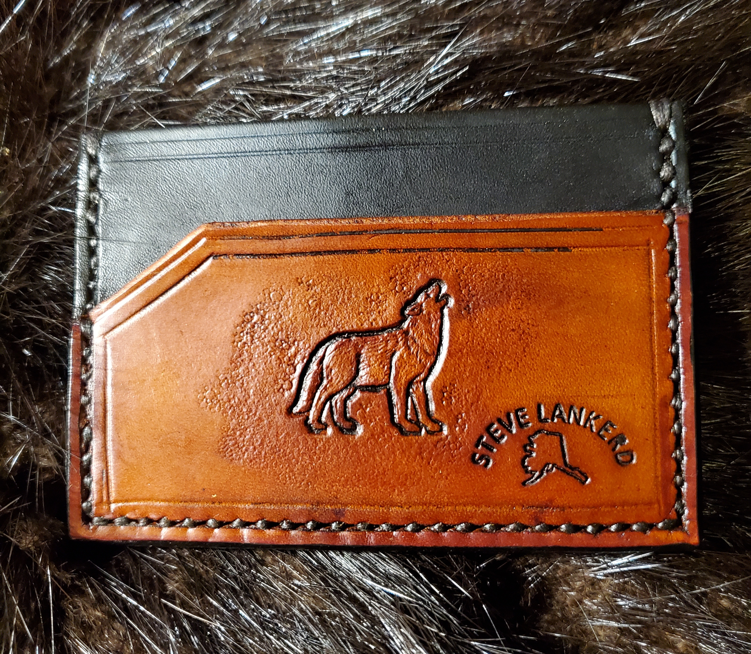 (Back)  Howling Wolf, 3 pocket Minimalist Wallet,  hand tooled, hand stitched,  $65.00