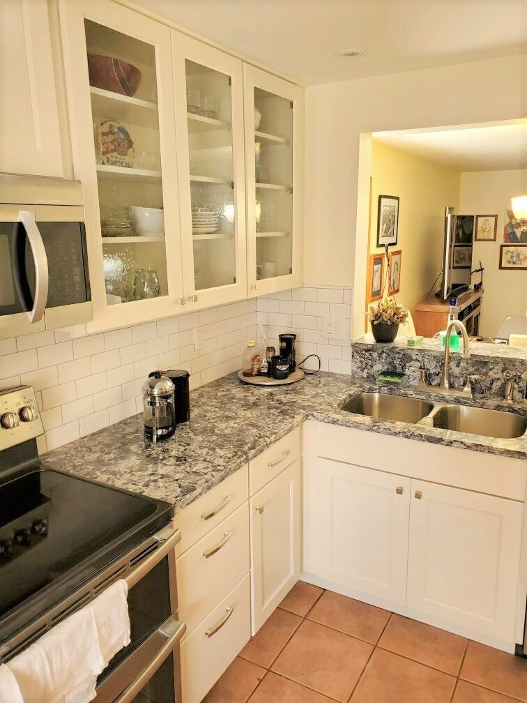 Classic kitchen featuring white subway tile backsplash and gorgeous countertops.