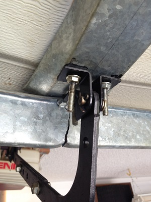 This is a Support Strut that broke from flexing after the door was damaged. Opener installed wrong as well.