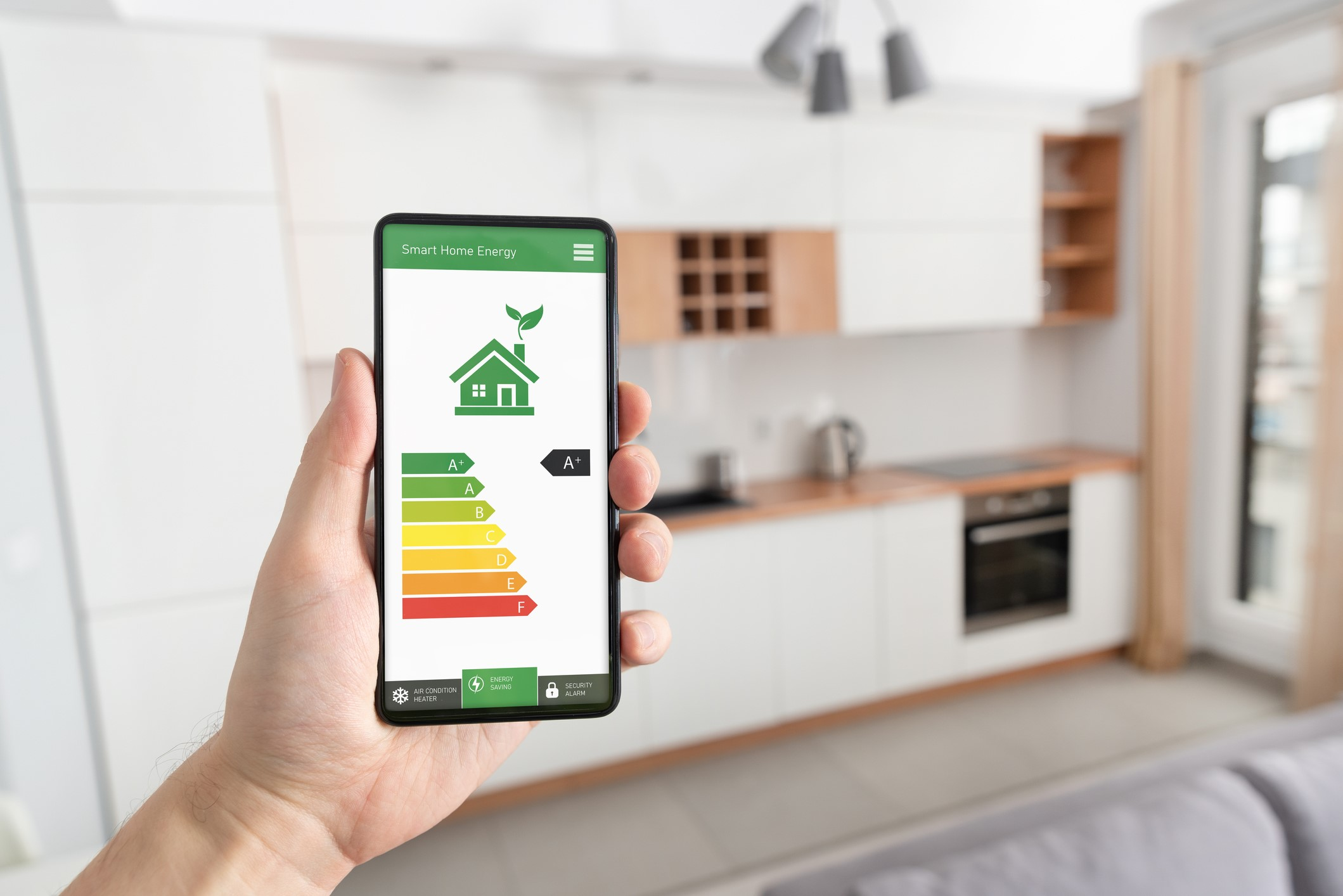 A homeowner using a mobile phone application to monitor and adjust the energy efficiency of their HVAC system