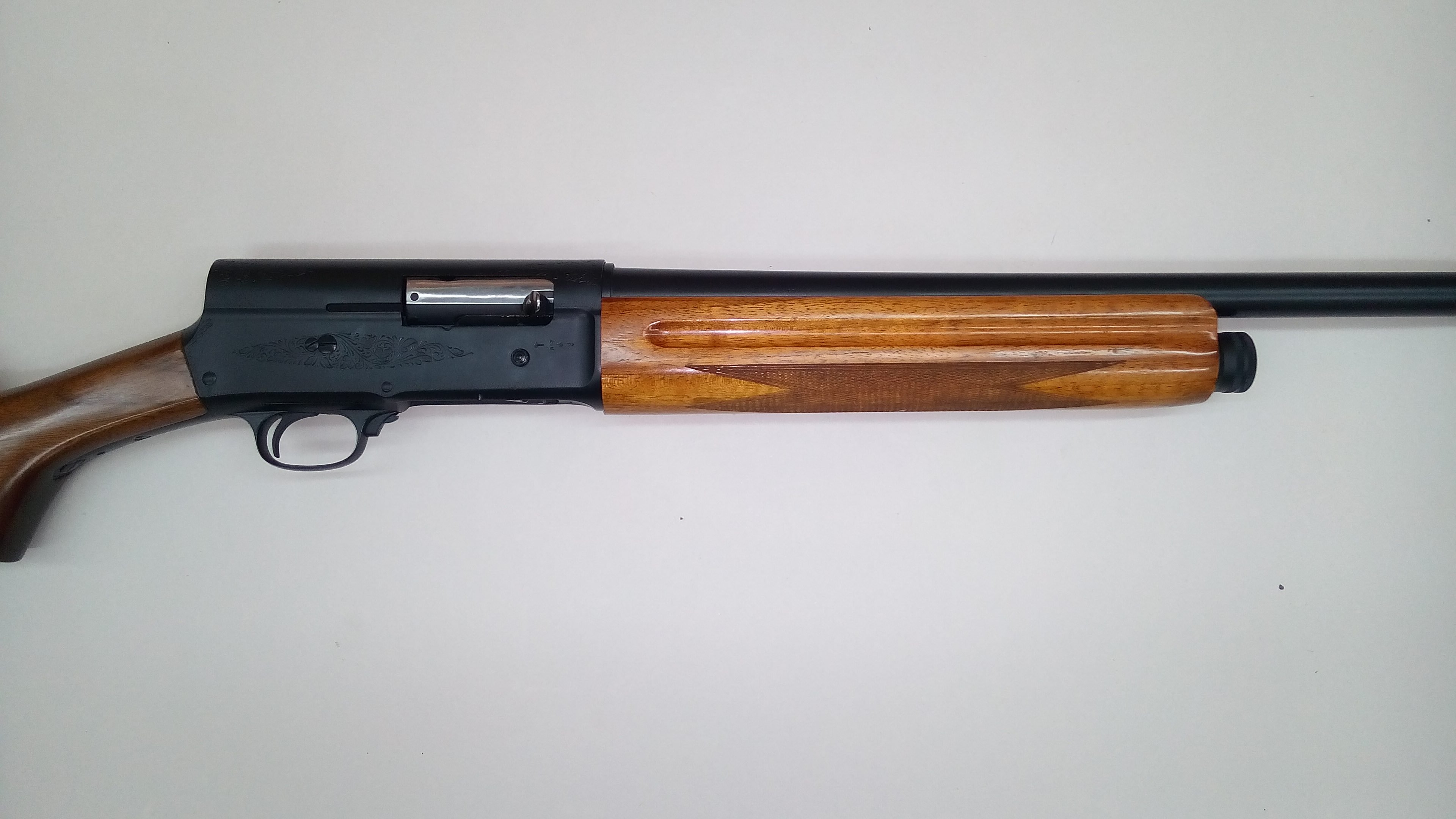 Browning a5 forearm refinished with high gloss polyurethane