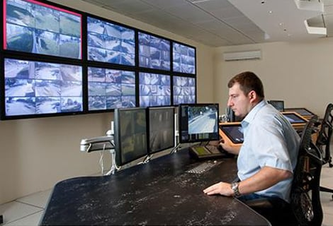 Man looking security monitor