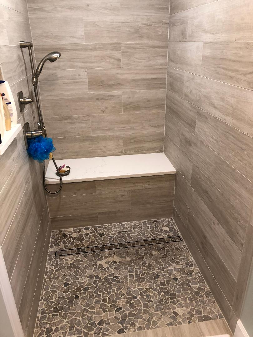 Featuring a linear drain on shower floor.