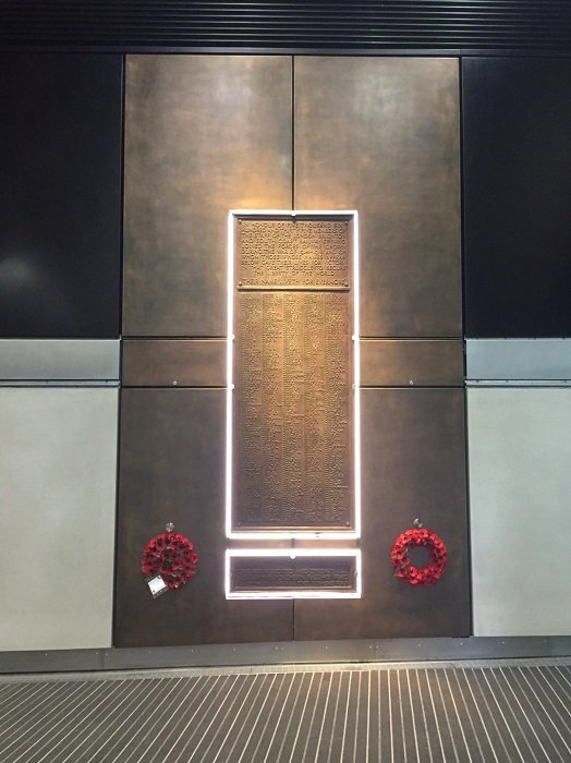 Specialist metal finishes. War memorial inside London Bridge Station. Surround cladding finished in Aged Bronze AM.7
