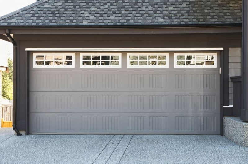 Grey and white garage door with windows
