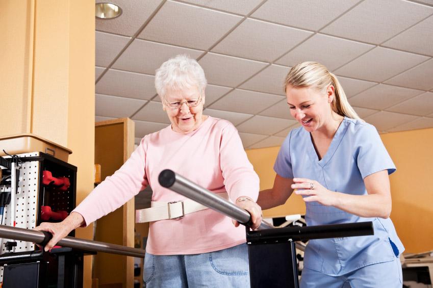 Physio therapist explaining to senior woman