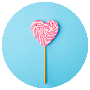 A Pink and White Spiral Heart Lollipop