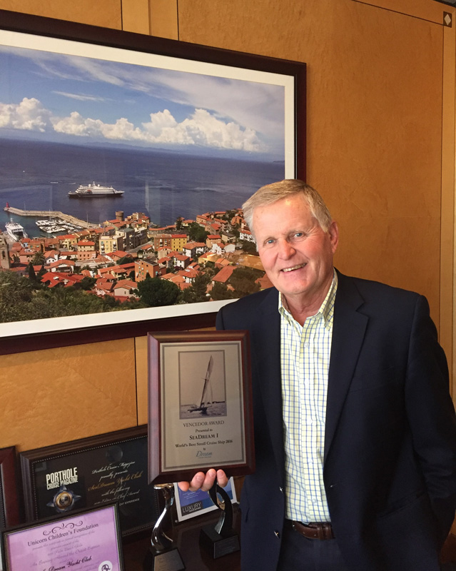 Robert Lopisto, President of SeaDream Yacht Club with the Vencedor Award given to SeaDream I
