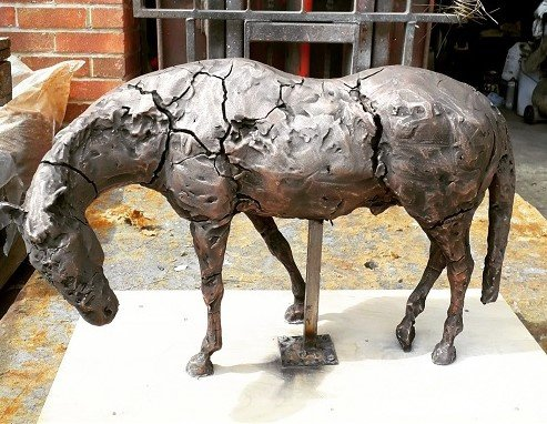 Applied bronze on clay sculpture - Artistic Metals