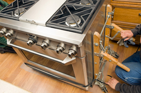 Man installing commercial stove