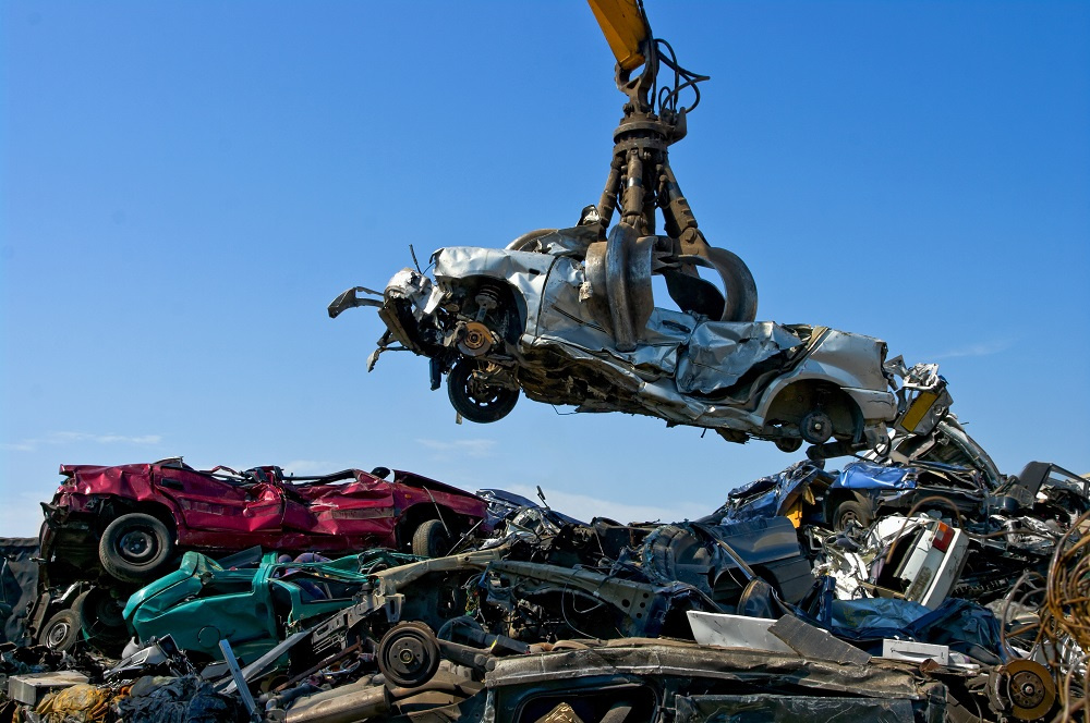 A Claw Crane Picking up A Salvaged Car