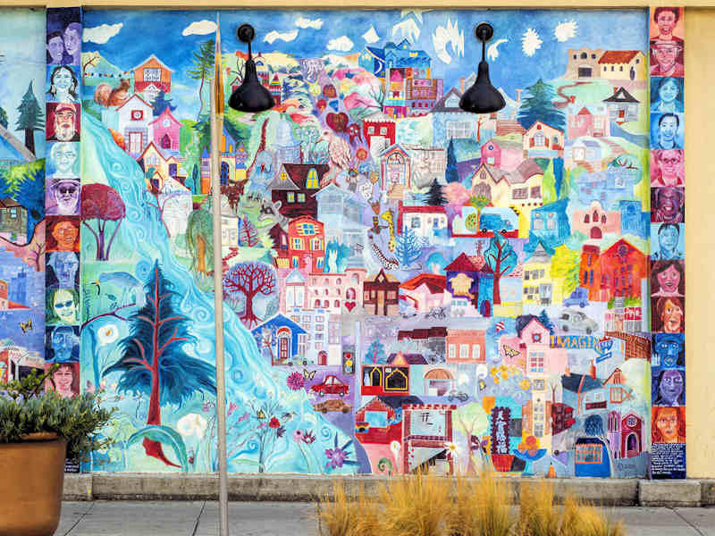 The work of community artist and educator Debra Koppman is seen throughout the neighborhood in mosaics and murals brought to life in collaboration with students and volunteers.