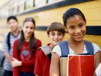Kids by school bus