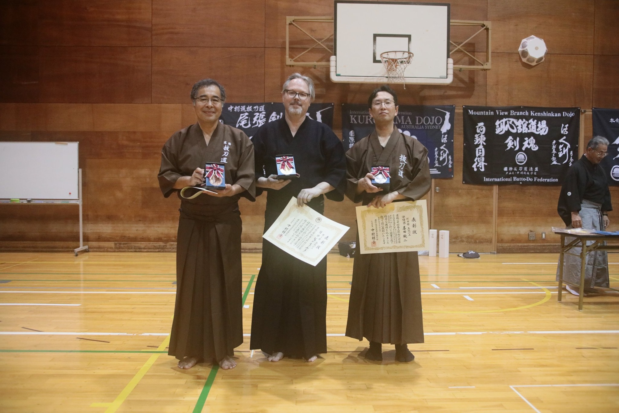 Tex with 1st place in Godan and above kata. You can see our new Dojo flag in the background - Nice!