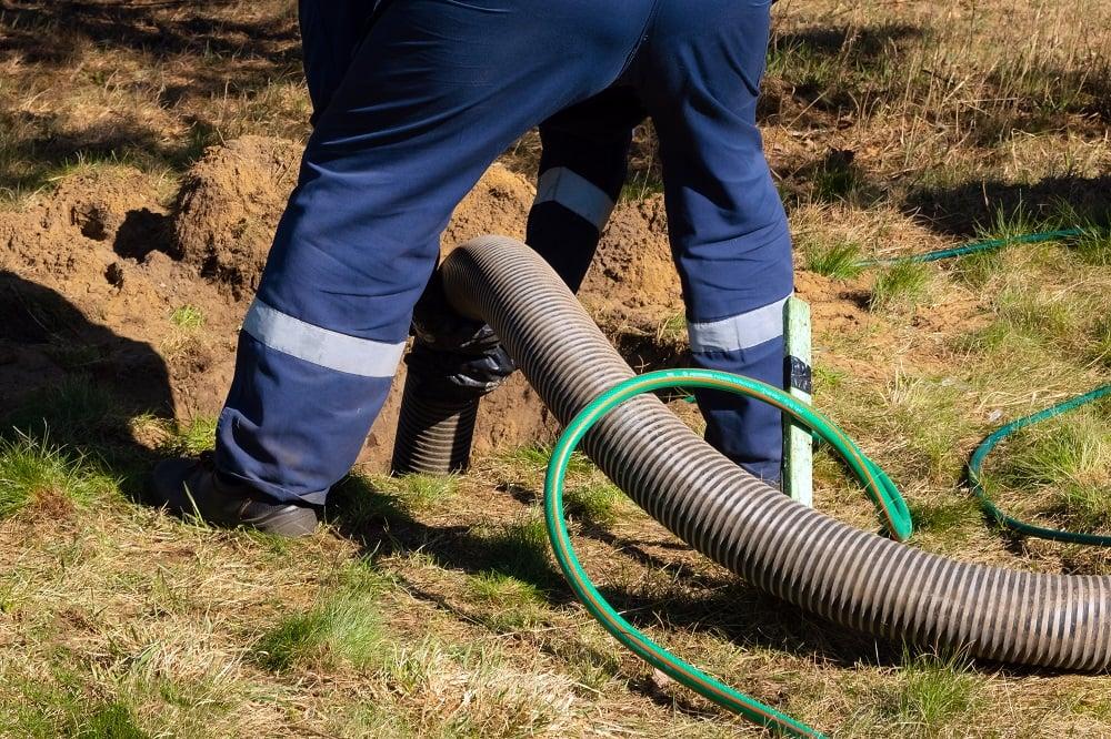 Man Draining Sewer Backup