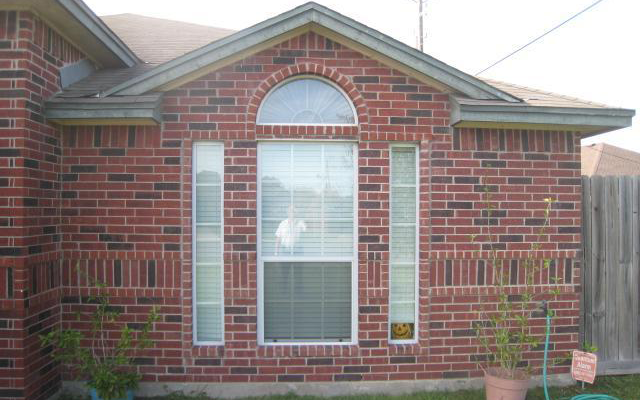 Repaired exterior of brick home