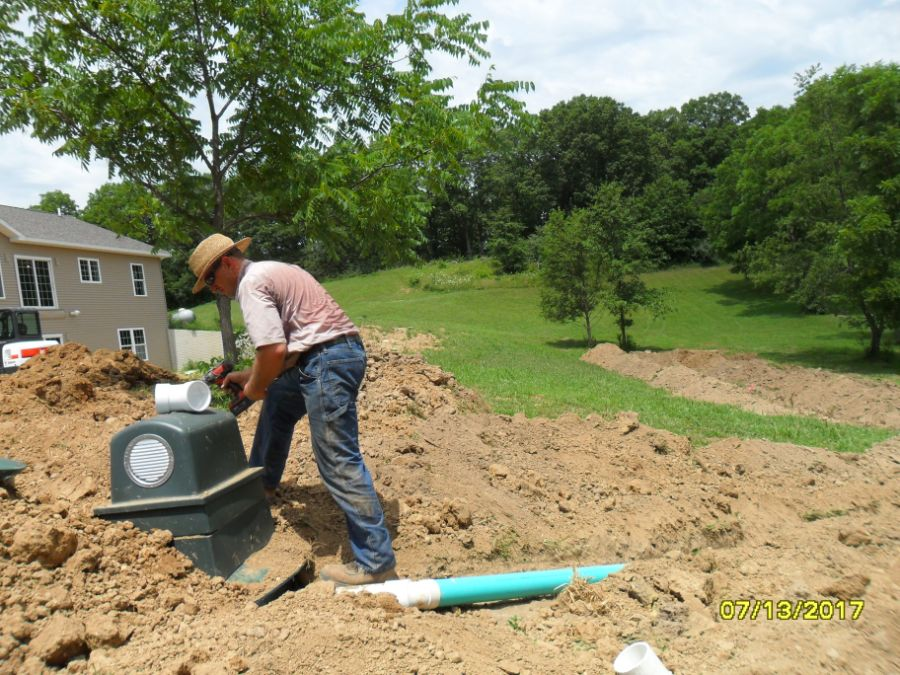 Completing aerator tank installation