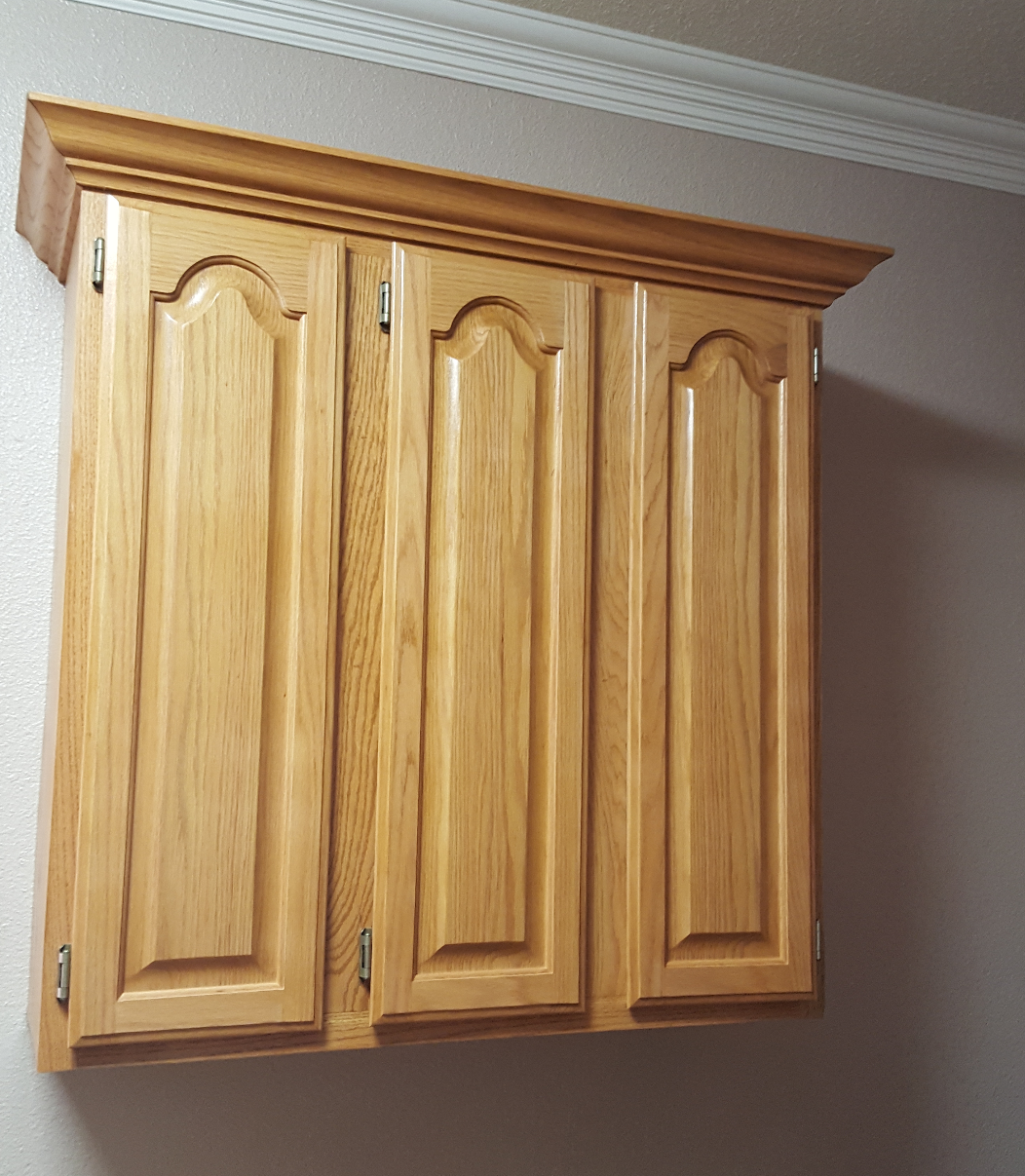 Features Crown Arched Paneled Doors  made of Golden Oak Stained Hickory Wood.