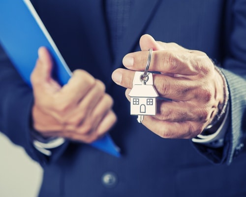 An Real Estate Agent Holding a House Key