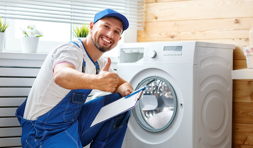 Man Repairs Washing Machine