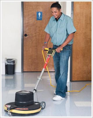 Maintenance man cleaning office floor||||