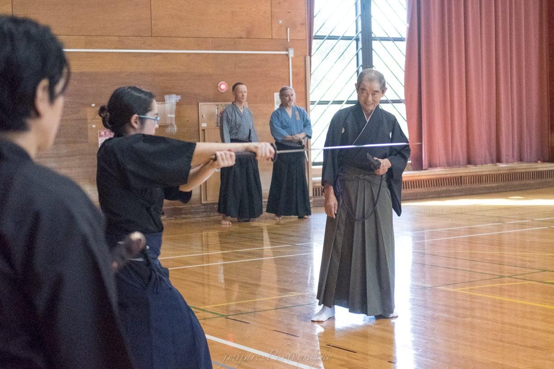 Vivian getting focused teaching from Nakamura Kenzo Sensei.