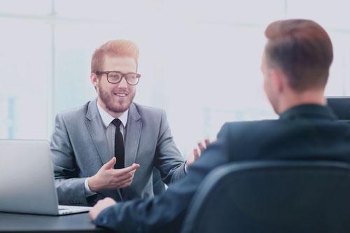 Happy Business People Talking on Meeting