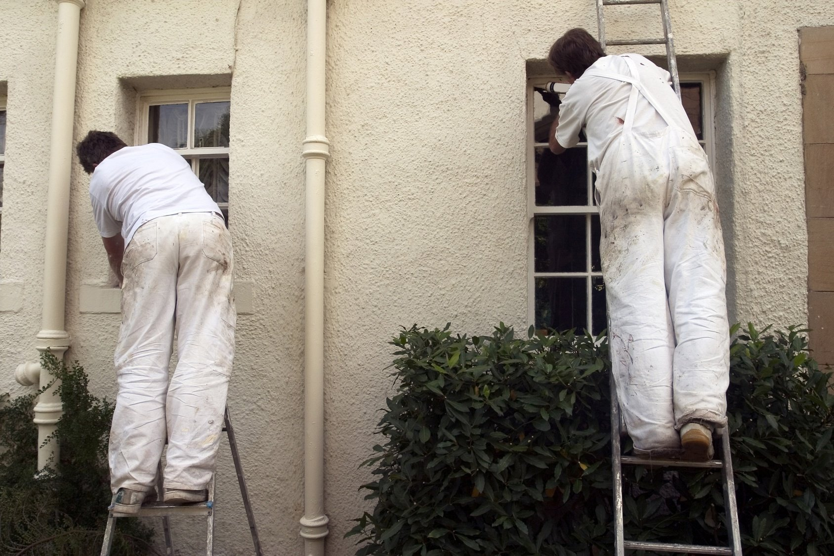 Two Men Painting a Home's Exterior