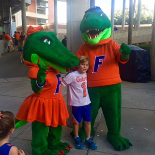 Henry. Social director. At gator game
