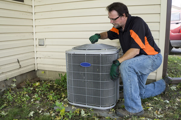 Repirman Tightening Fan Shroud On Outside Air Conditiong Unit