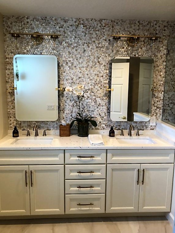 Double vanity featuring Sunny Pearl quartz countertop with Shore Penny Seashell  backsplash.