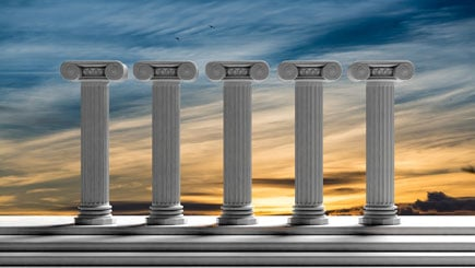 Five Ancient Pillars With Sunset Sky Background