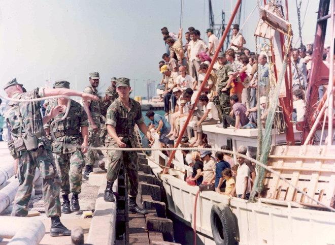 Scores of Cubans board watercraft to leave Cuba during El Mariel Boatlift (circa 1980s)