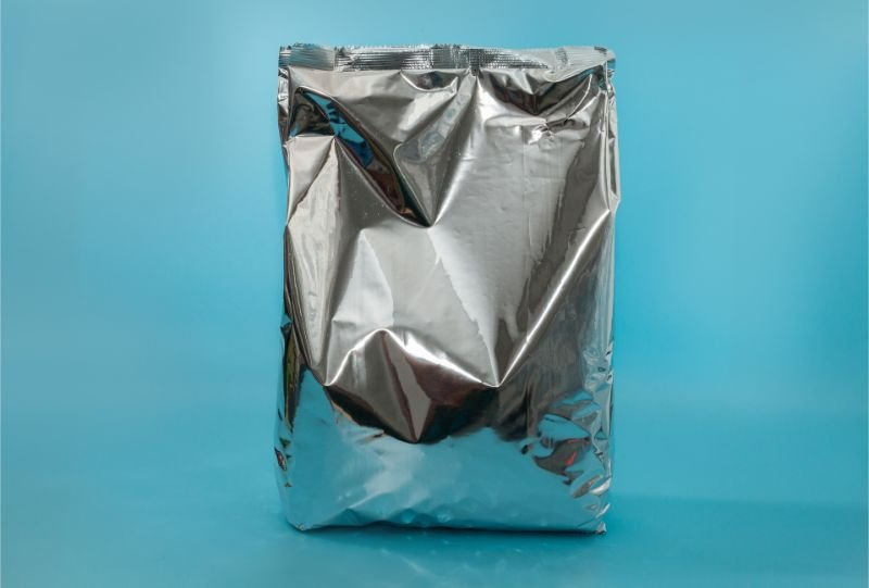 Snack foil bag on blue background