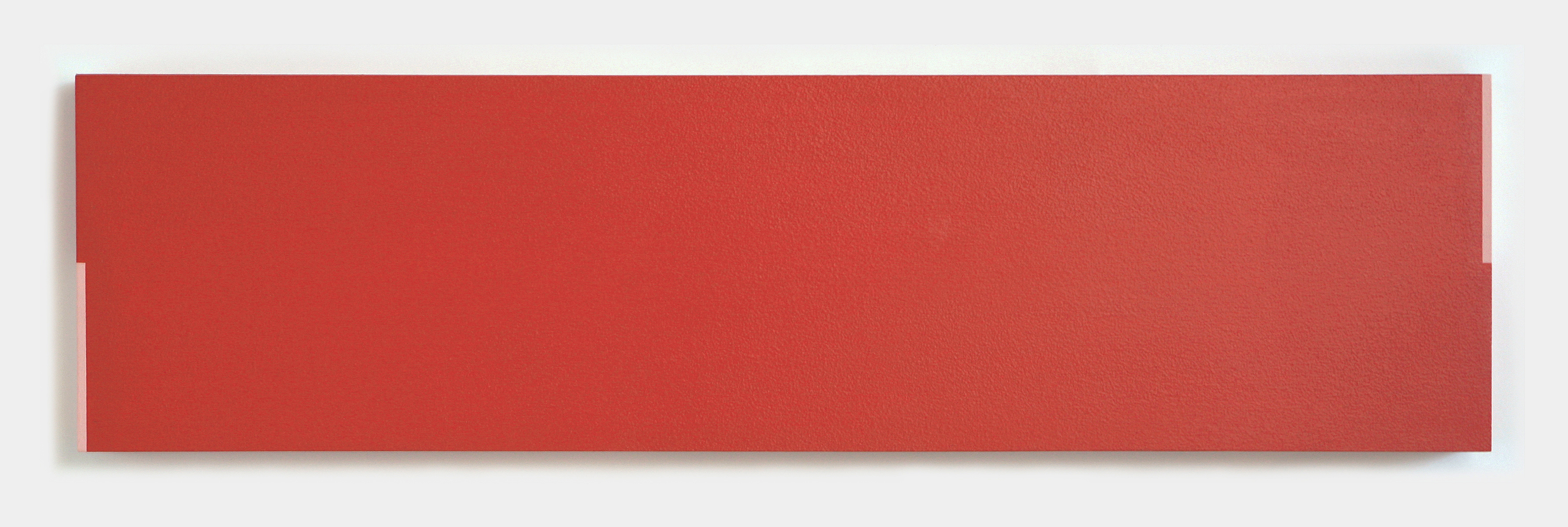 A long rectangular red painting with thin pink rectangles painted on two corners.