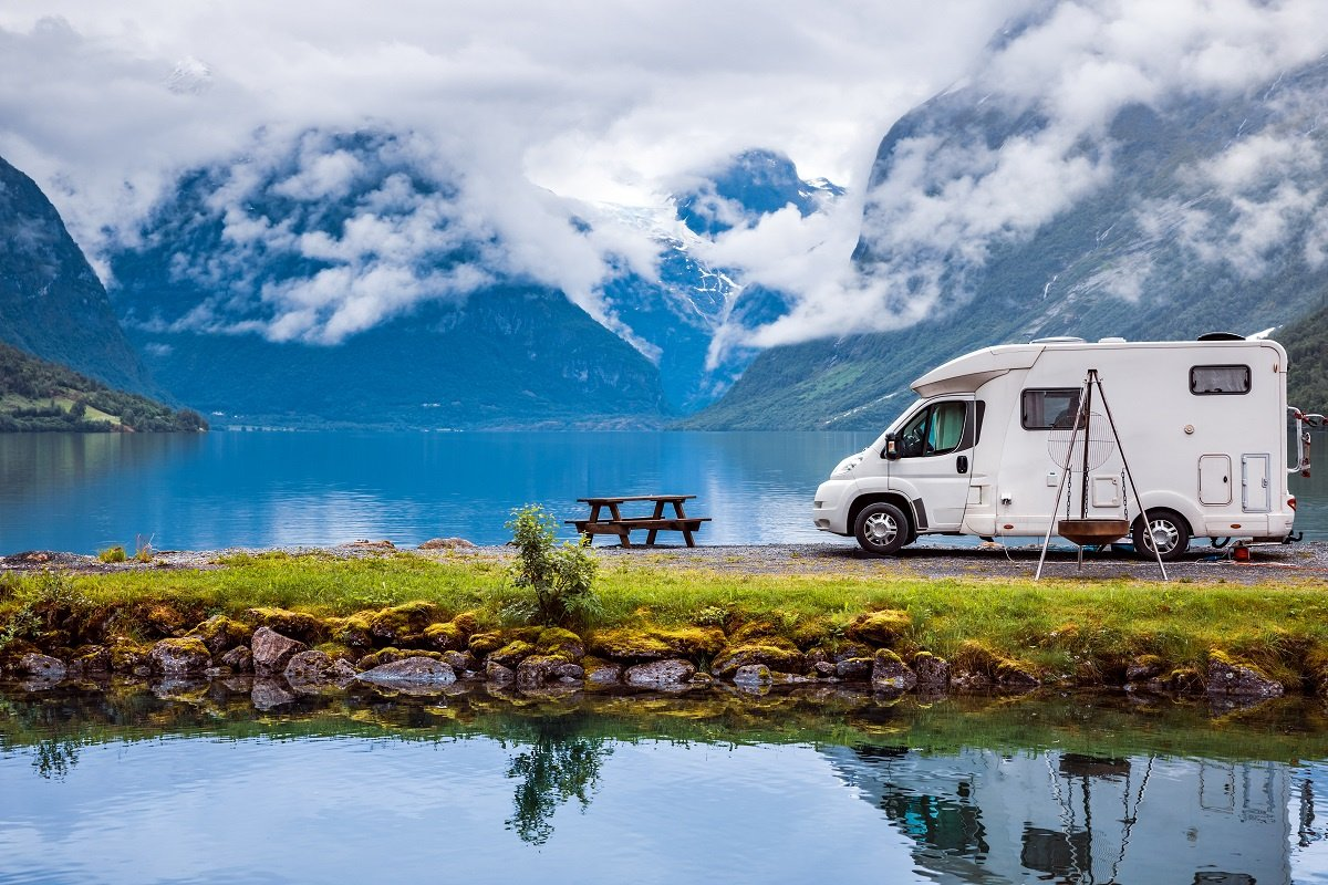 RV Next to a Beautiful Lake and Mountain
