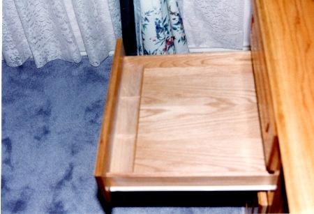 Drawer has a three section well, good for  pencils, pens, paper clips, etc.