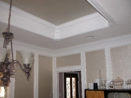 Middle raised ceiling is cased with dentil crown molding.