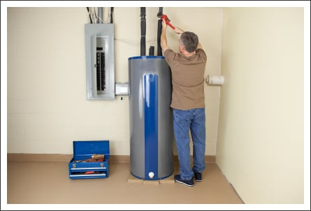Plumber fixing water heater||||