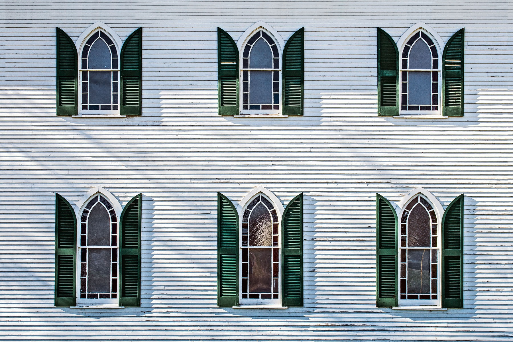 FLYING WINDOWS - The windows in this photo occupy one side of an old church building close to Big Bone Lick state park in northern Kentucky. Maybe they're angels' wings.