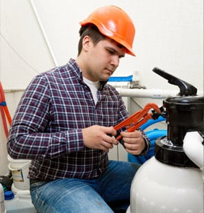 Plumber installing manometer on high pressure barrel