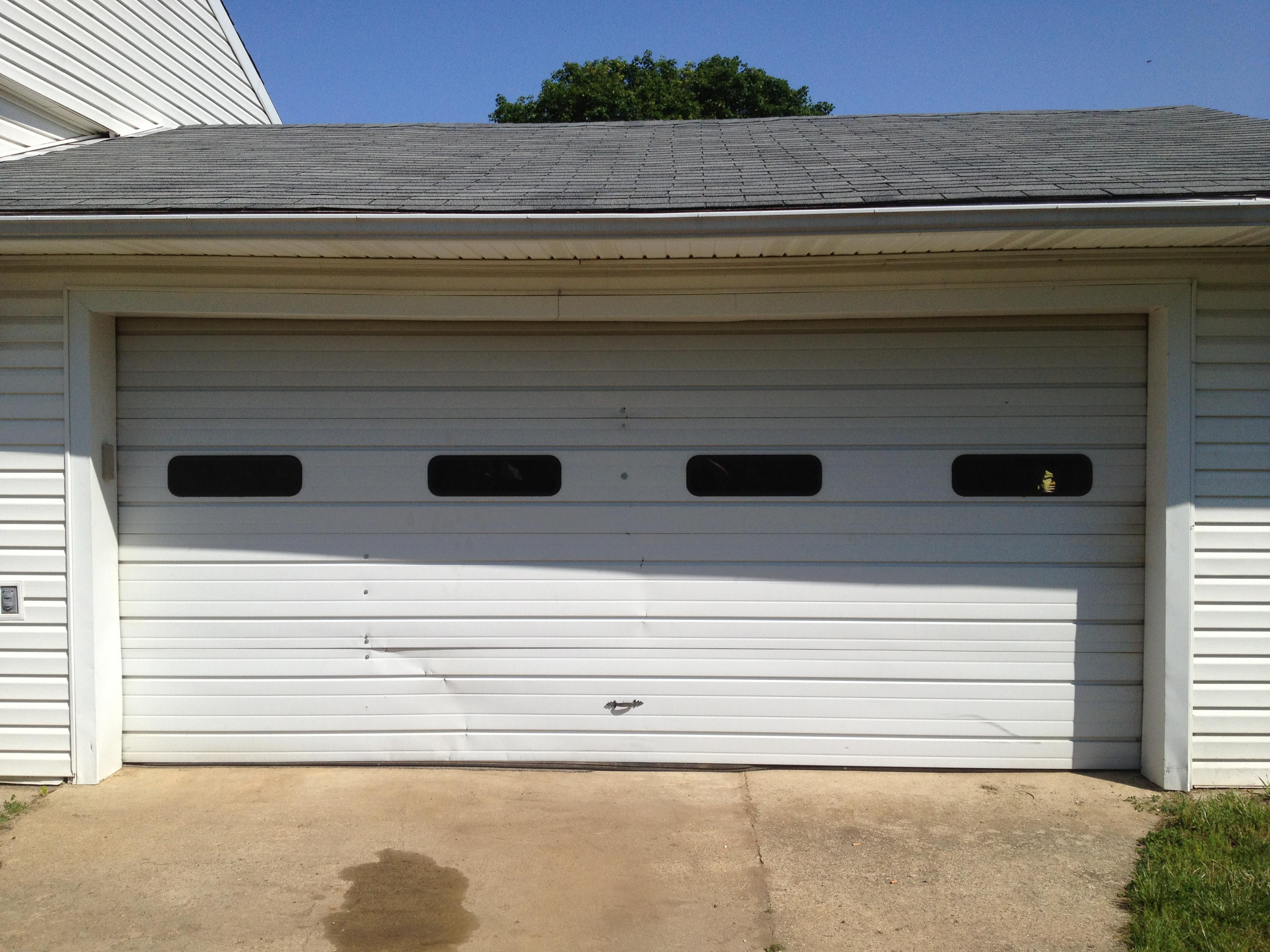Ingstrup construction battle creek overhead doors for 16x7 garage door prices