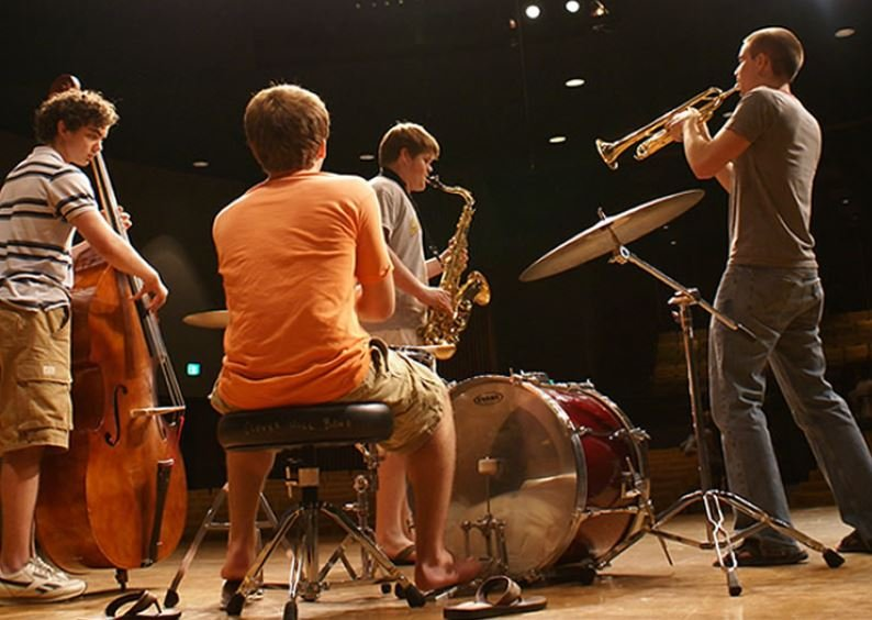 Students play music in the Jazz band.