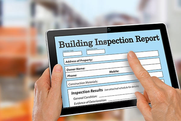 Buiding Inspector Completing an Inspection