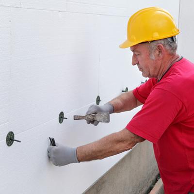 Construction Site Styrofoam Insulation Worker