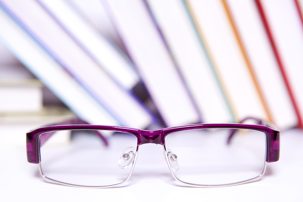 Glasses in front of books||||